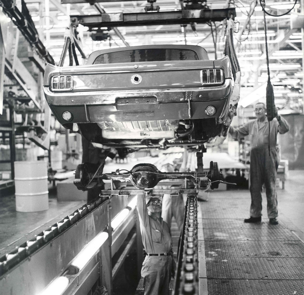 On The Padded Fingers Of An Assembly Line Hoist At Ford Motor Companys